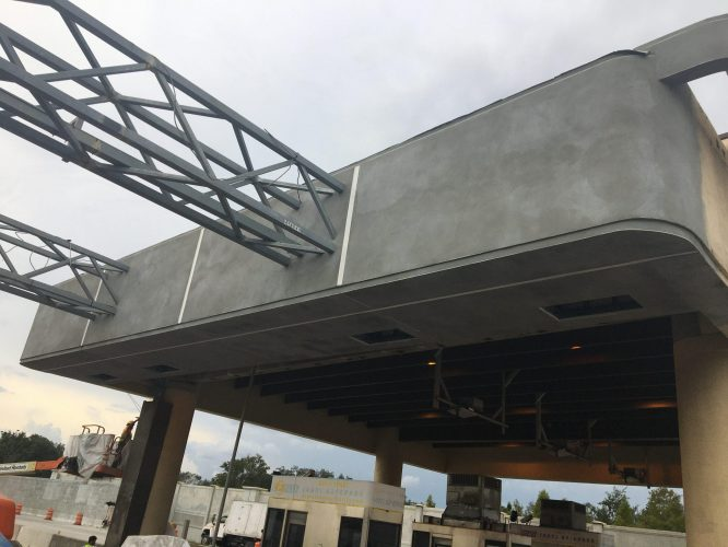 Orlando General Contractor finishing stucco of toll booth canopy